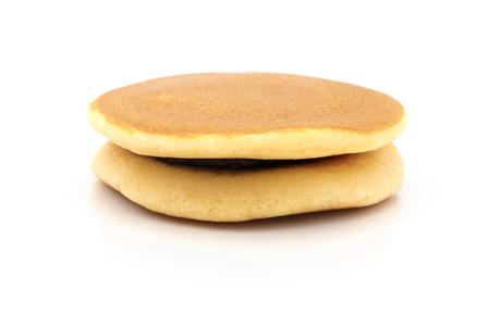 teacake: Dorayaki, Japanese Sweet Bean Pancakes on the white background Stock Photo