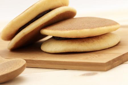 teacake: Dorayaki, Japanese Sweet Bean Pancakes on the wood background