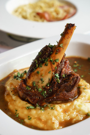 Braised lamb shank on the mashed potato in the restaurant