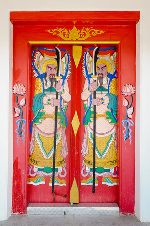 daunting: Traditional Chinese gods on the temples gate in China Town, Bangkok, Thailand Stock Photo