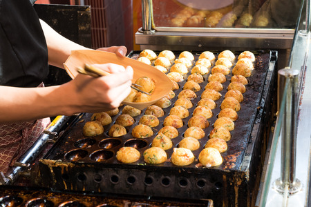 Cooking of Takoyaki one of the most popular food in Osaka, Japan