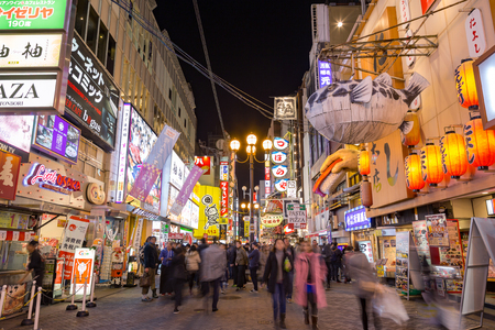 characterized: Osaka, Japan - December 4, 2015: in Dontonbori, Namba area. Dotonbori is a popular nightlife and entertainment area characterized by large illuminated signboards.Tourists come to come to see the fancy billboard, shopping and have dinner at night.
