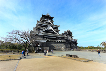 Kumamoto, Japan - November 11, 2015: Kumamoto Castle is a hilltop castle in Kumamoto Prefecture, Japan. It was a large and extremely well fortified castle. The castle keep is a concrete reconstruction built in 1960. Tourists can access and see a panorama