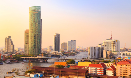 tr: Bangkok, Thailand - March 9, 2016: Skyscraper and Cityscape in Bangkok; many modern condominiums and business building on Sathorn and Silom road which presents Thailands economic growth gradually. Now a day, the government attempt to expand the railway tr Editorial