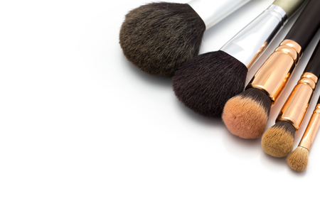 defining: Professional cosmetic brushes isolated on the white background