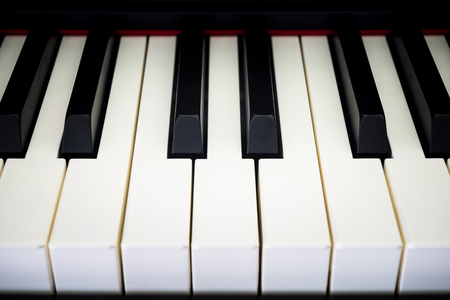 acoustically: Piano keys with shallow depth of field
