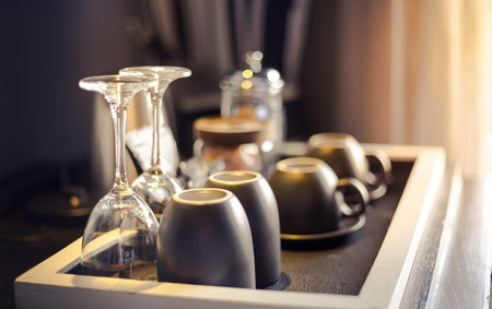 Cups and glasses in hotel room
