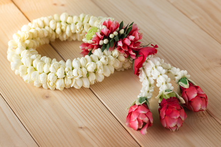Traditional Thai jasmine garland on the wood background Stock Photo