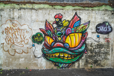 public space: Bangkok, Thailand - January 21: Graffiti wall in the Saphanlek Area, Bangkok government change the illegal commercial area to be the public space and graffiti artistes come to create their work on wall.