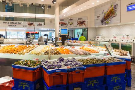 fish vendor: Sydney, Australia - February 24, 2017: Various seafood in Sydney Fish Market, Sydney. Editorial