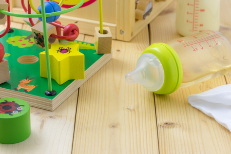 Baby milk bottle and toys Banque d'images
