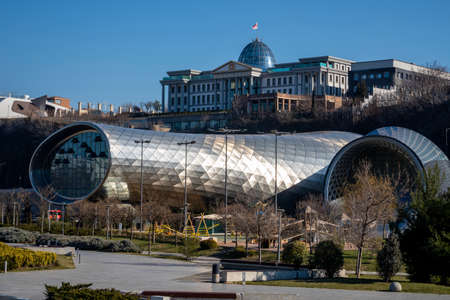 TBILISI, GEORGIA - Mar 4, 2019: View of Presidential Palace of Georgia and Concert Music Theatre Exhibition Hall in Rike park Éditoriale