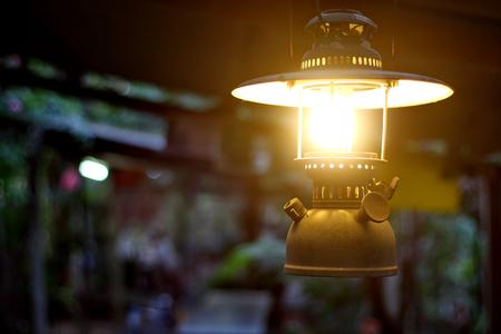 Storm lantern light is  hanging on the bar.