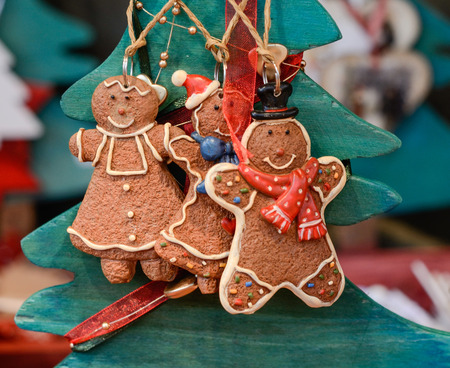 Christmas market in details. Three funny gingerbread cookies - Christmas toys.