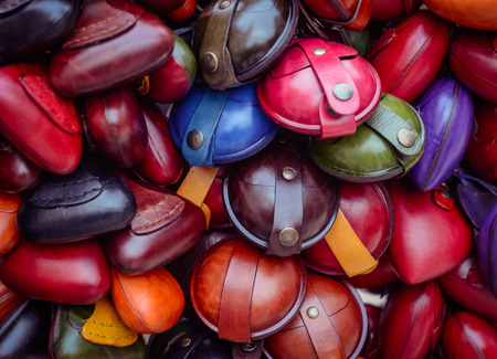 Christmas market in details. Colorful small leather goods, purses for coins.