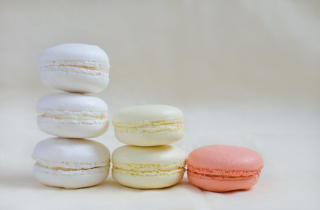 Macarons colored in pastel colors - white, yellow, pink photo