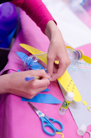 handicrafts: Doing handicrafts airplane from paper and bottle