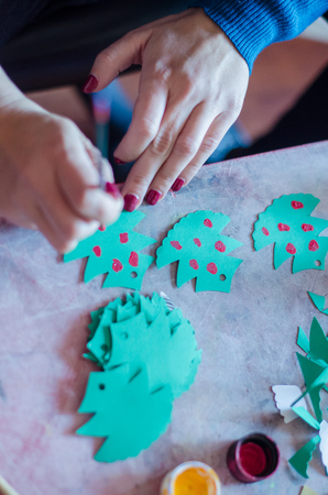 handicrafts: Doing handicrafts Christmas trees from paper and colors