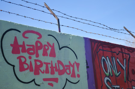 barbwire: Graffiti art - the wall with barbwire and happy birthday