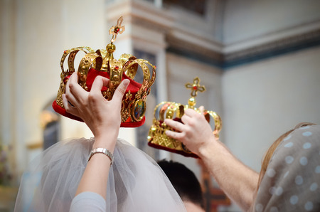 witnesses: Wedding in Orthodox Church -  witnesses held bridal crowns over the head