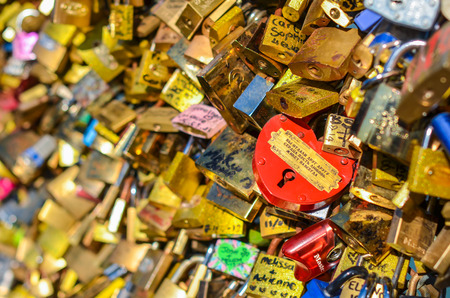 out of engagement: PARIS - APRIL 2014: Love Padlocks at Pont des Arts on April 17, 2014, in Paris. The thousands of locks of loving couples symbolize love forever. Editorial
