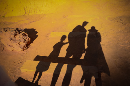 ochre: Family of three on the red ochre ground in Roussillon