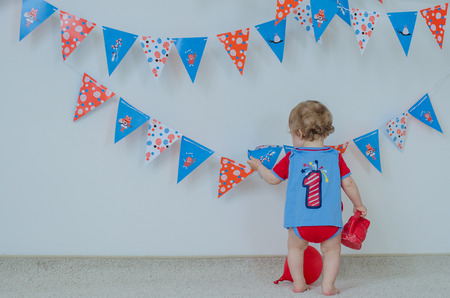 messy clothes: One year-old birthday and decorations Stock Photo