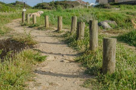 restraints: Winding path leading from the beach upwards near Porto Covo, Portugal.