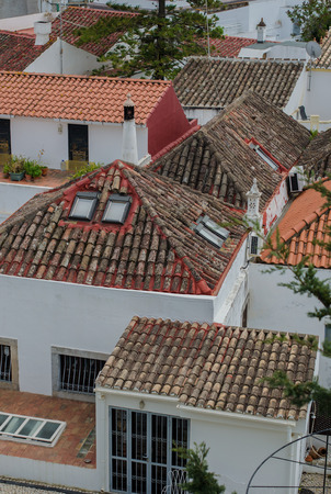 Picturesque Portugal town Tavira - tile roofs, narrow streets 免版税图像 - 102009194