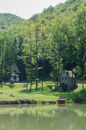 Old water mill in the park Schonborn in the Voyevodyno, Ukraine Standard-Bild
