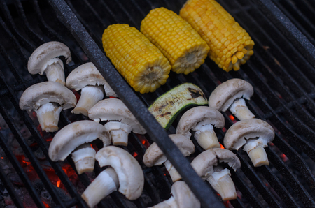 Barbeque close up of vegetables - mushrooms, eggplant and corns
