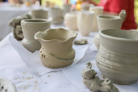 Freshly made on potter's wheel: vases, pots, jars and plates