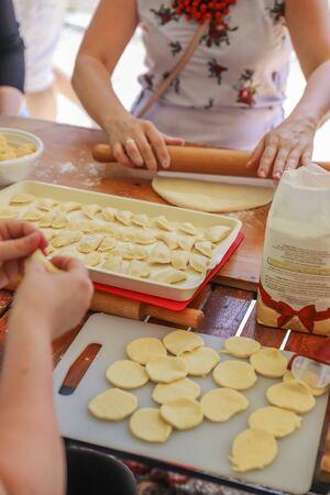 Preparation a lot of dumplings for a big family