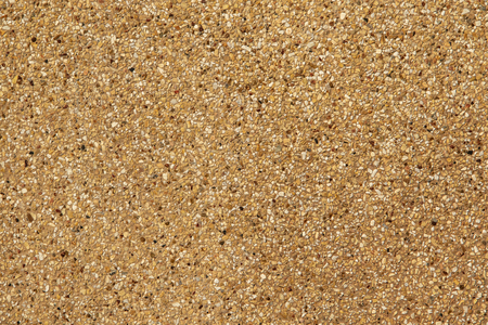 Exposed aggregate finish. Washed sand. Texture and background.