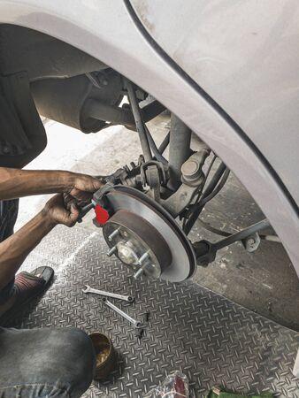 Change brake pads. Machanic change break pads on car. Stock Photo
