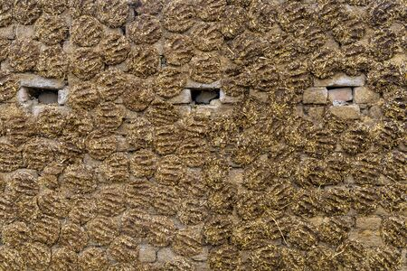 The wall of the house is made of dung in India.