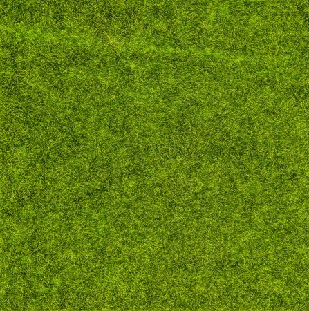 Close-up green artificial grass for texture and background.