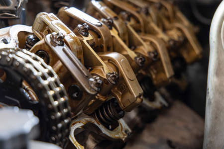 Close up Guide Valve Lifter and Camshaft engine of car.