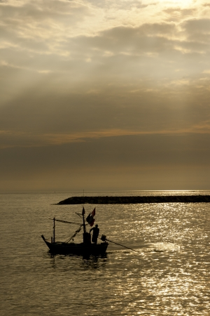folkways: silhouette of fisherman at HuaHin, Thailand