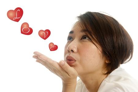 kisser: asian pretty woman sending kisses on white background