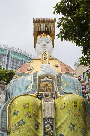 repulse: Big Buddha Statue in Kwan Yin Temple on Repulse Bay, Hong Kong Stock Photo