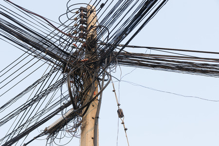 messily: Cabel large number of ropes suspended disorderly