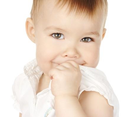 bashful: Shy child turn and smile, isolated over white