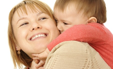 Cute child play with mother, riding on her shoulders, isolated over white Stock Photo - 4289586