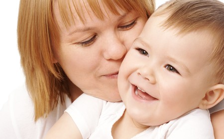 Mother embracing her happy child, isolated over white Stock Photo - 4289567