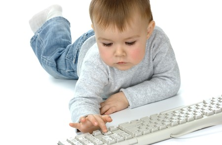 Cute child typing on a keyboard, isolated over white Stock Photo - 4289581