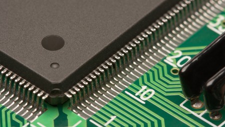 soldered: Extreme closeup of a chip on circuit board
