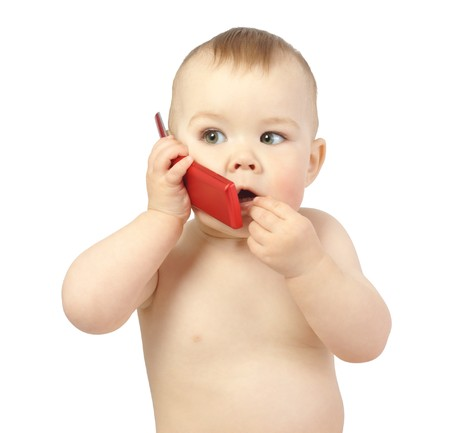 talking telephone: Cute child talking to a cell phone, isolated over white Stock Photo