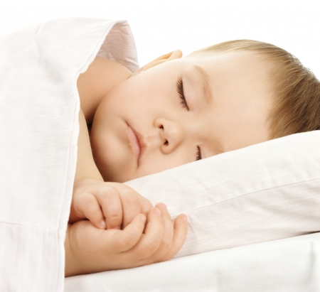 Cute child is sleeping in bed, isolated over white Stock Photo