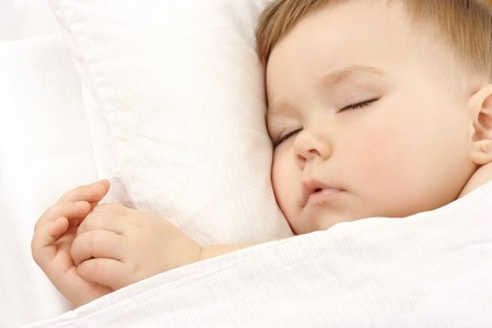 baby sleeping: Cute child is sleeping, high key portrait